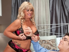 The 51-year-old cougar takes a 21-year-old schlong in her ass
